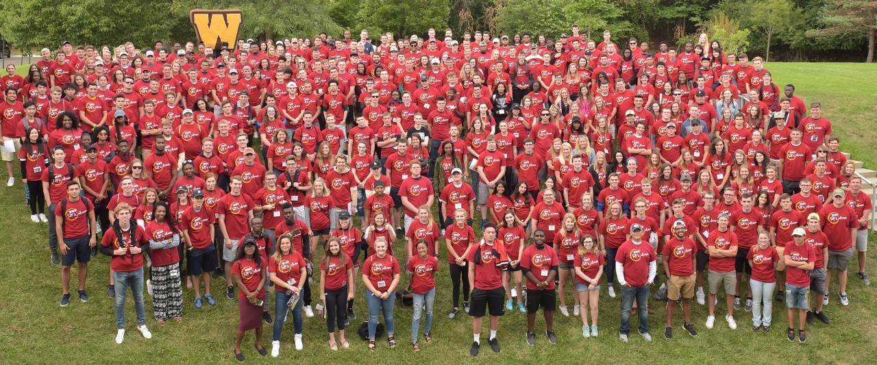Large group of students in red t-shirts.