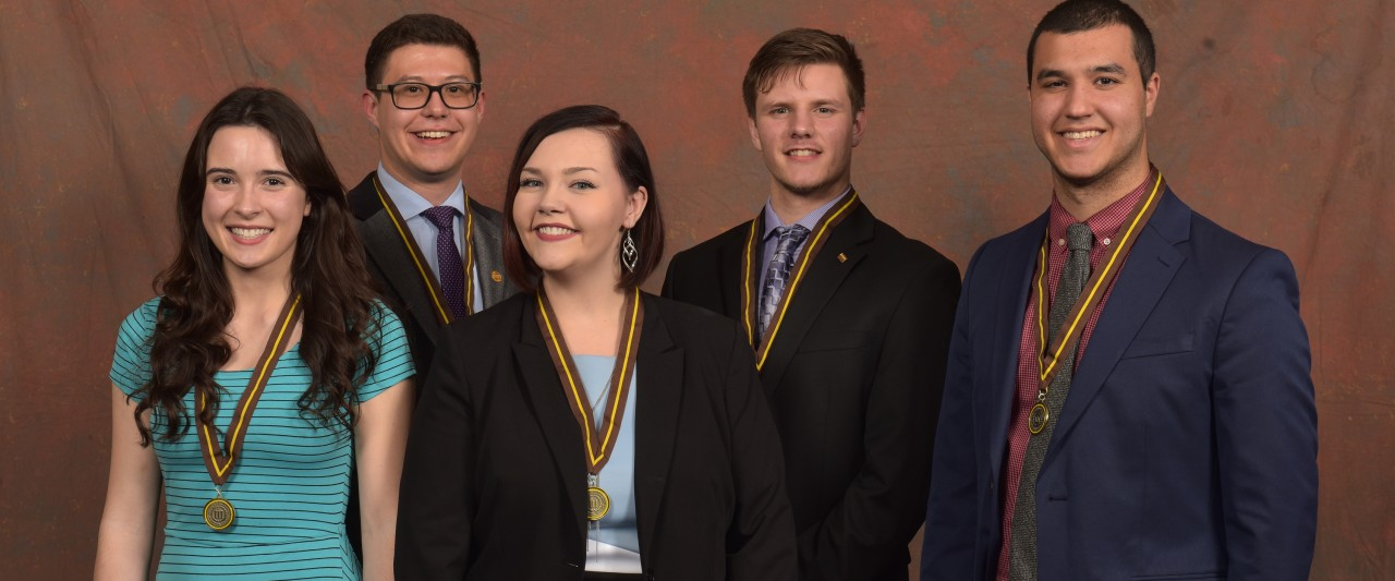 Five of six business presidential scholars shown in professional dress with medals.