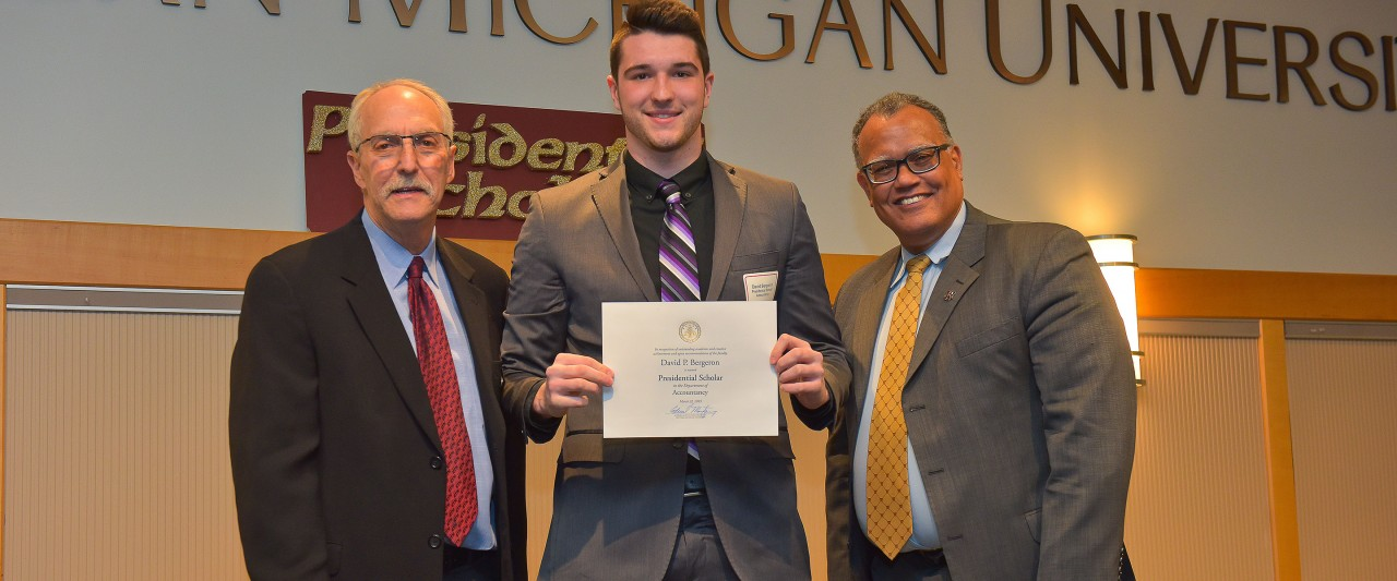 Bergeron with WMU president and president of the WMU faculty senate during the award ceremony.