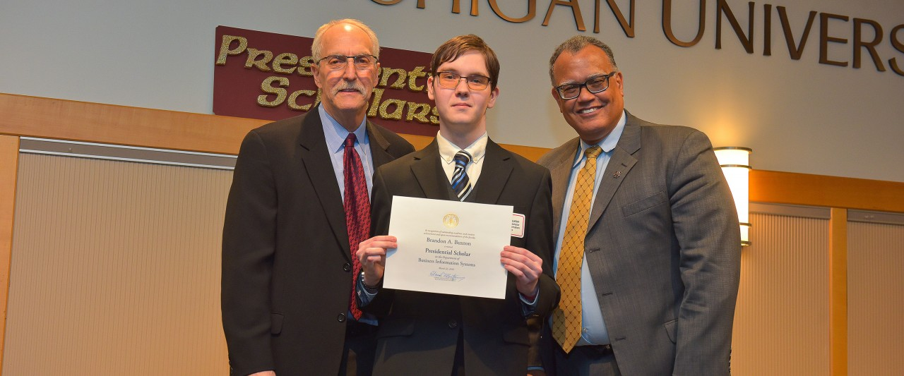 Buxton with WMU president and president of the WMU faculty senate during the award ceremony.