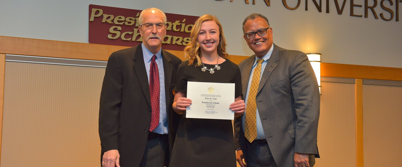 Erika Hejl with WMU president and president of WMU faculty senate during award ceremony.
