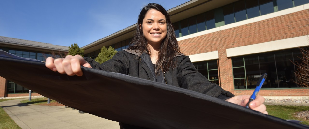 Amber Delgado with her invention, BlueBoards