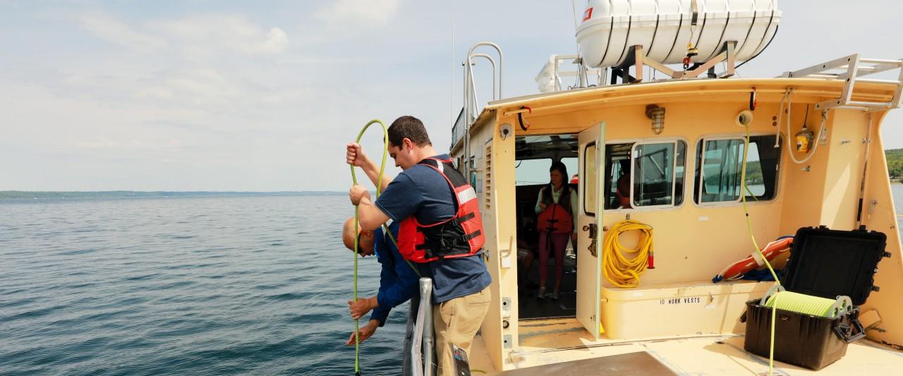 Photo of Zack Ladwig retrieving a submarine.