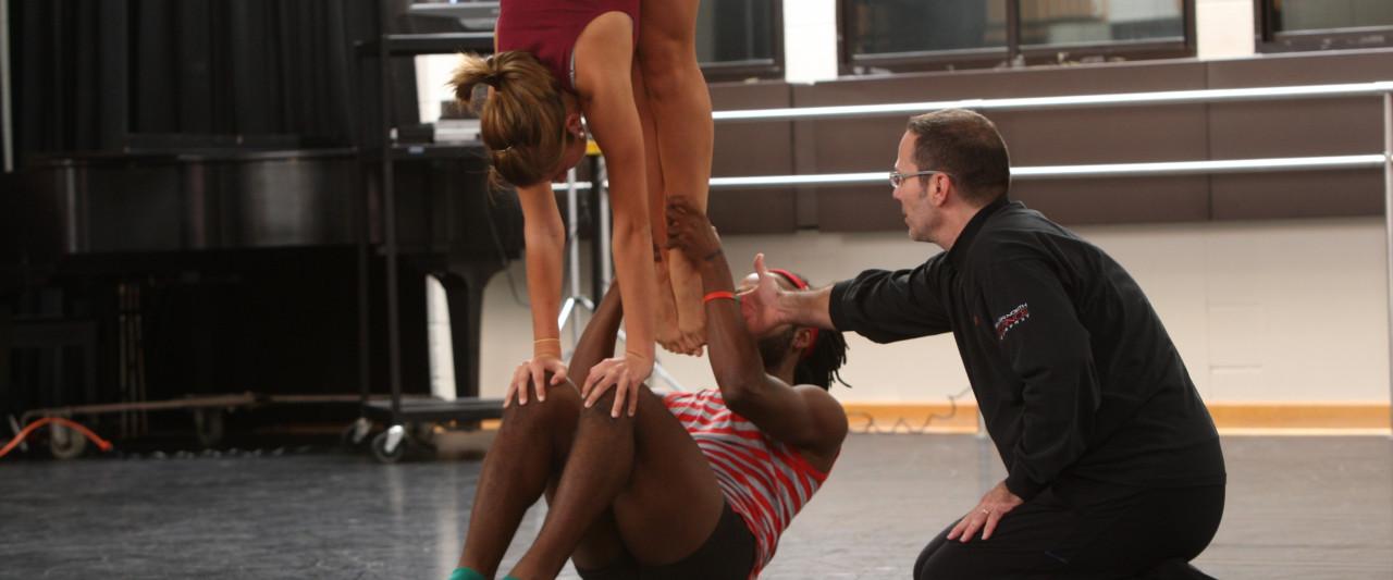 Guest artist, Frank Chaves, teaches 2 WMU dancers in rehearsal.