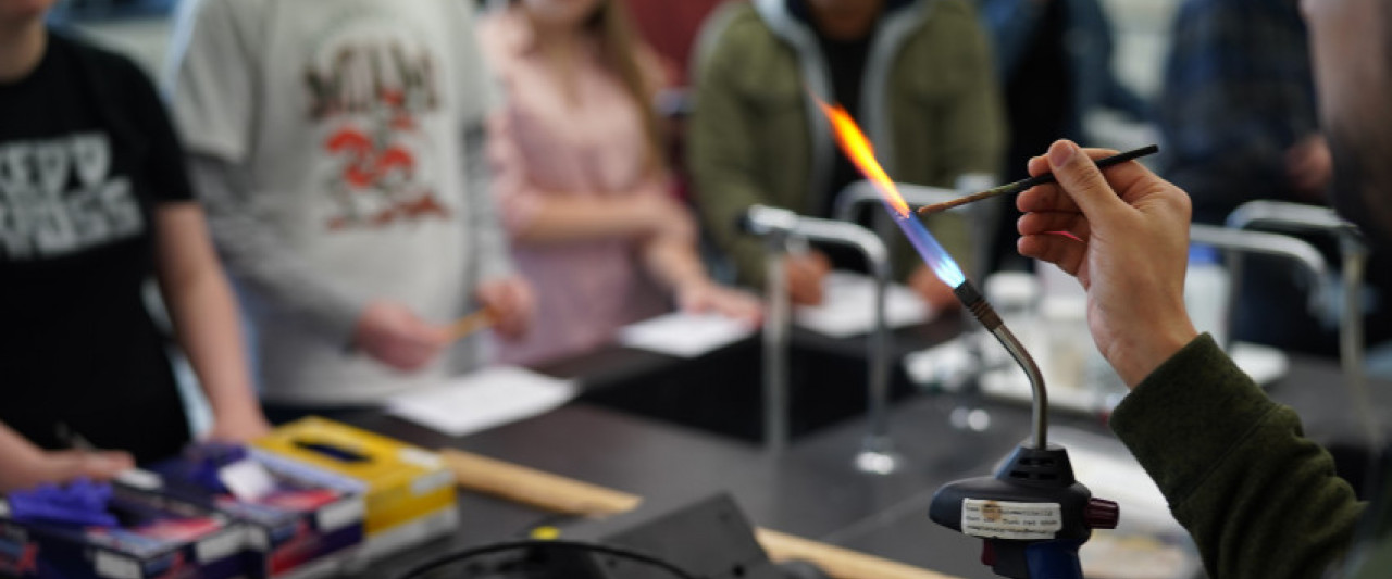 A chemistry class at WMU demonstrating a flame test.