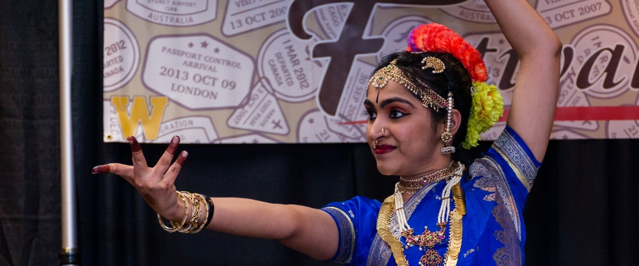 Pakistani student in traditional dress performs at the 2018 International Festival.