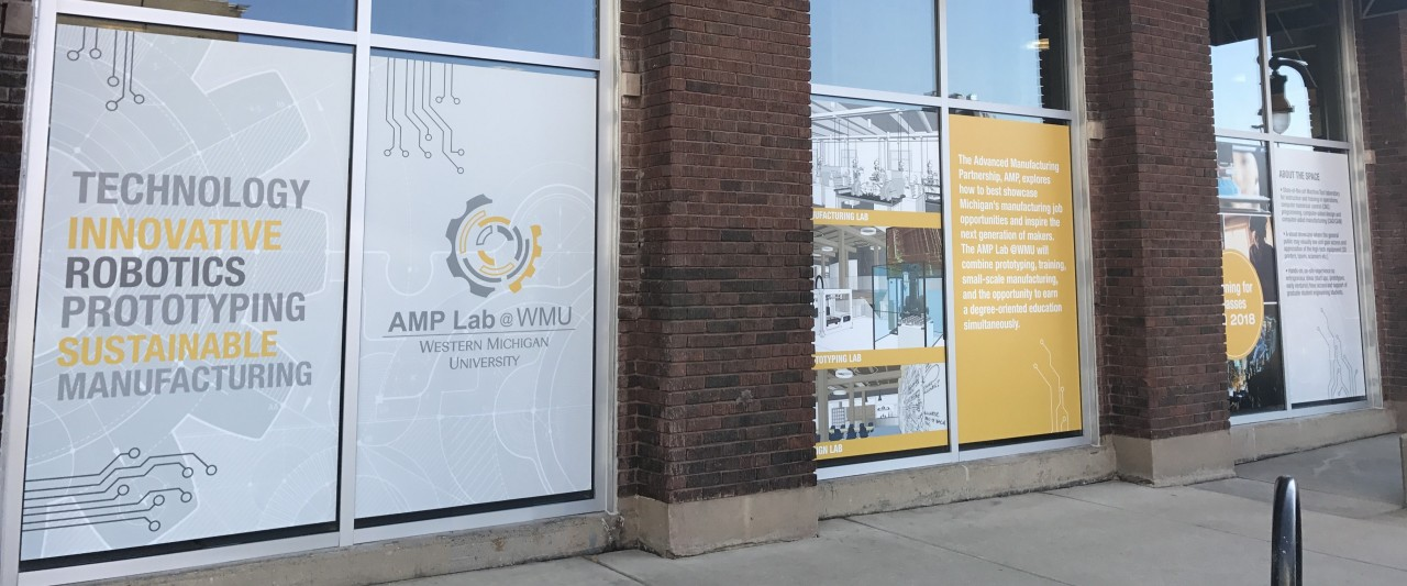 AMP lab windows decorated with branding signage