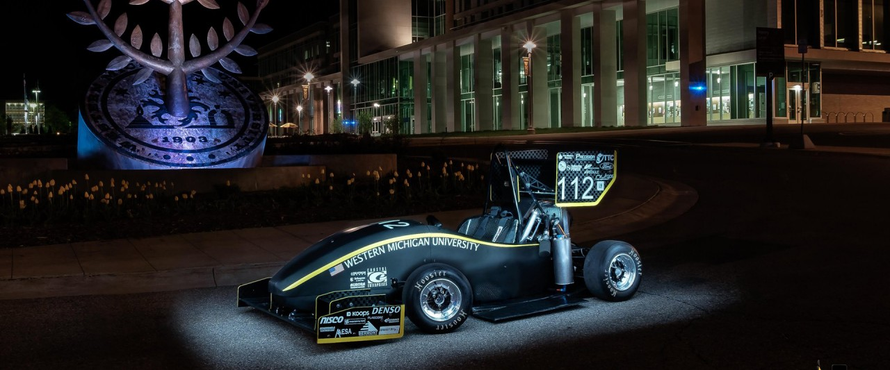 WMU's Formula SAE vehicle displayed in front of Sangren Hall