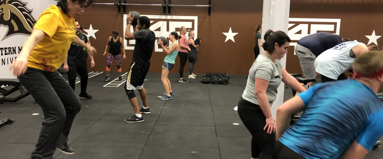 Participants working out in the F45 studio doing a variety of exercises