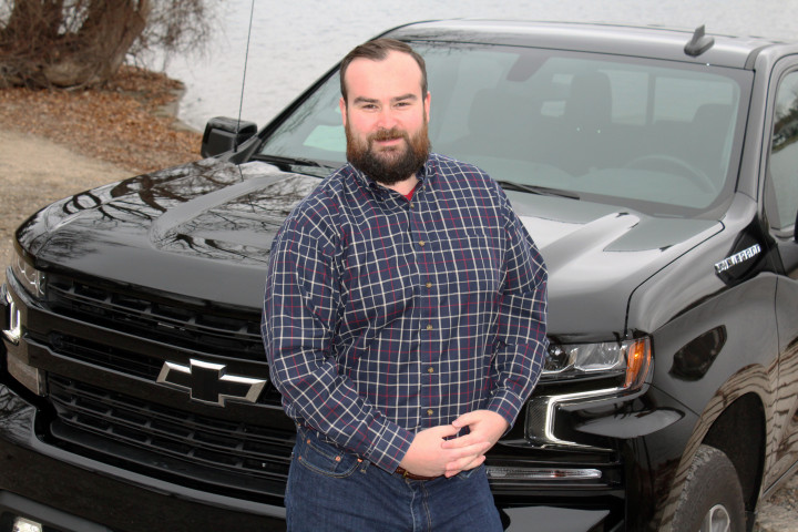 Pictured is Michael Schwandt leaning on a black truck