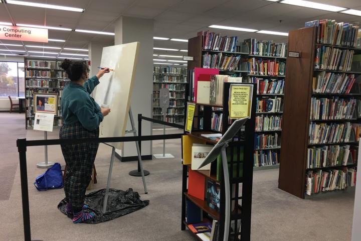 Darien Burress painting in Waldo Library.