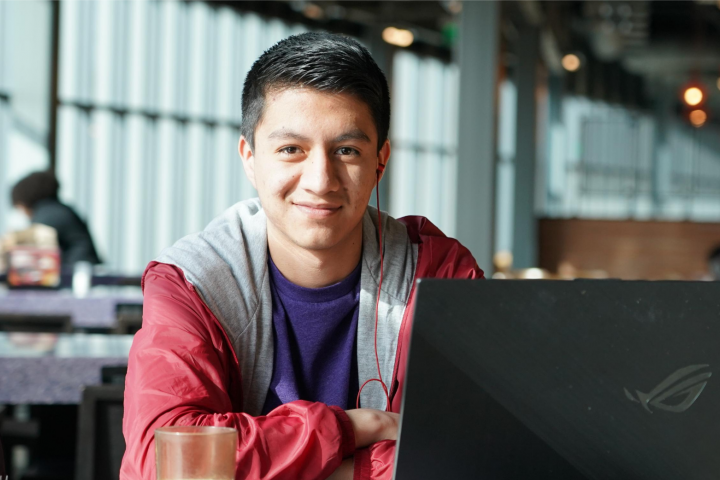 Male student sits at table in Valley Dining Center