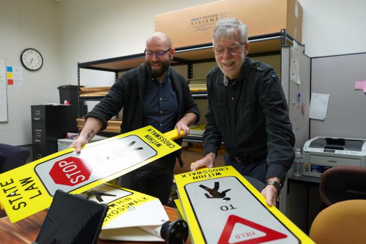 Dr. Ron Van Houten with pedestrian cross walk signs
