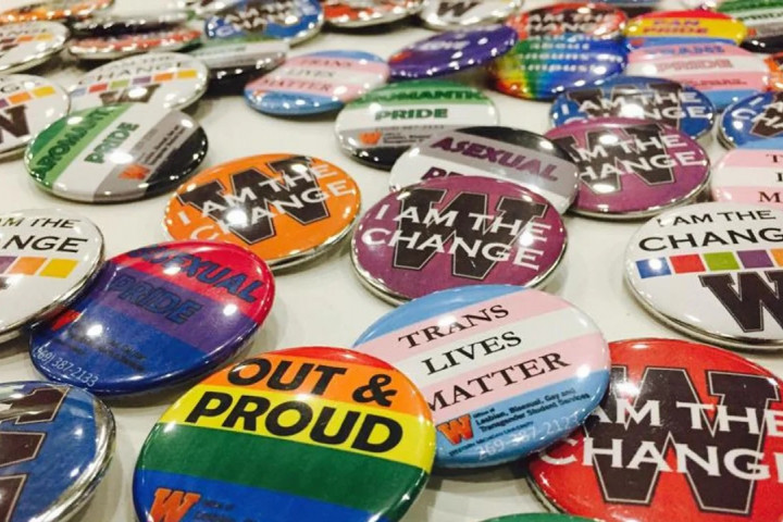 Various button pins with sayings on them