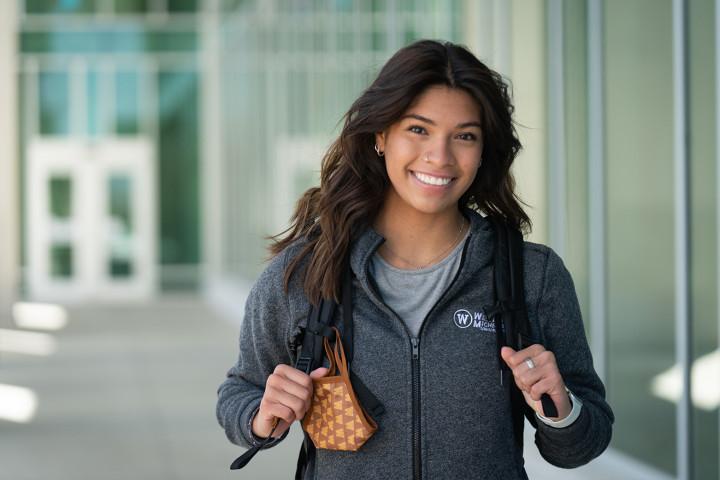 Student walks in front of Sangren Hall