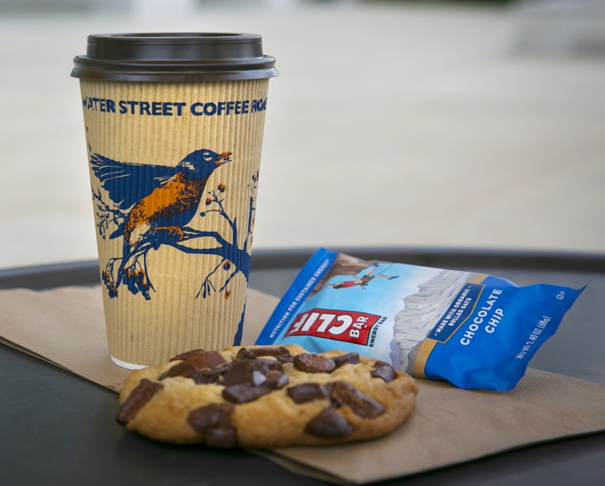 Water Street Coffee, CLIF bar, and cookie on table