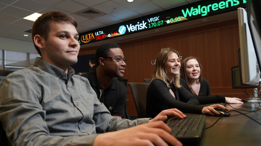 Pictured are students in the Greenleaf Trading room.