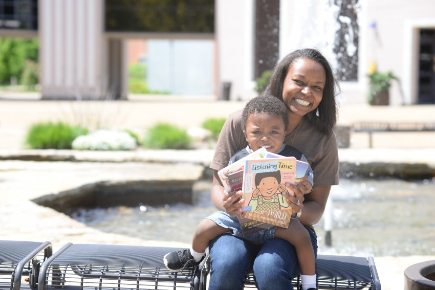 Precious Miller with son holding books
