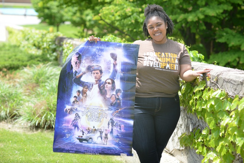 Melissa Holman with a movie poster