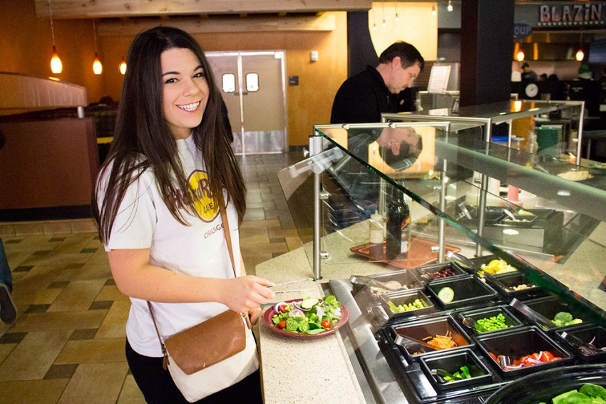 Female student at Bistro3 salad bar