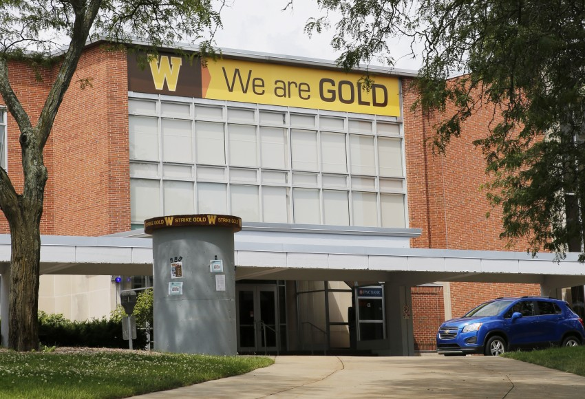 "Photo of Bernhard Center with ""we are gold"" banner on front"