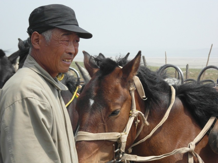 Man and horse in Inner Mongolia, China.