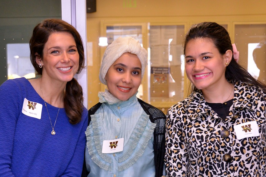 Three female students at a WMU School of Communication donor celebration event.