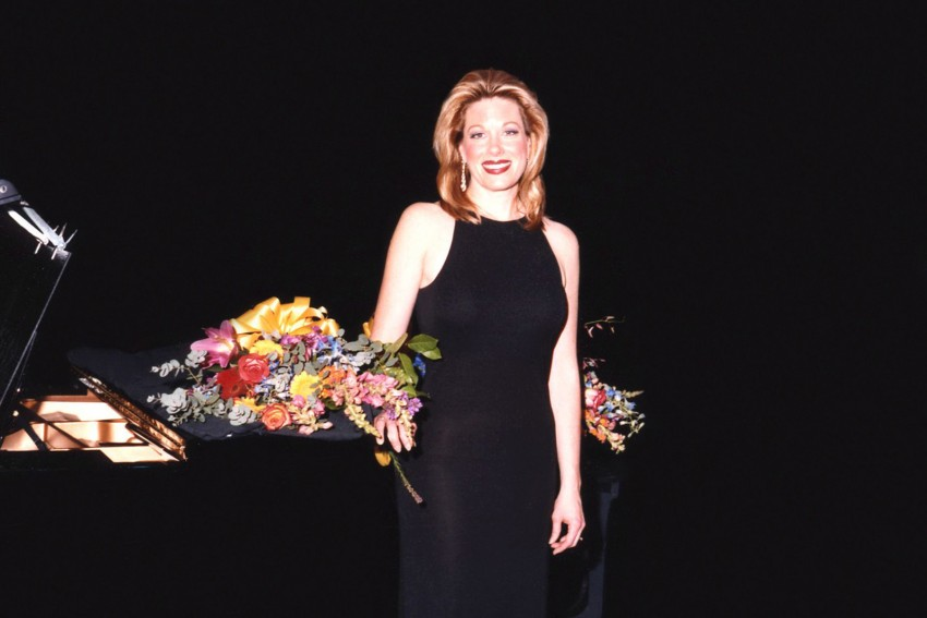 Marin Mazzie poses with flowers.