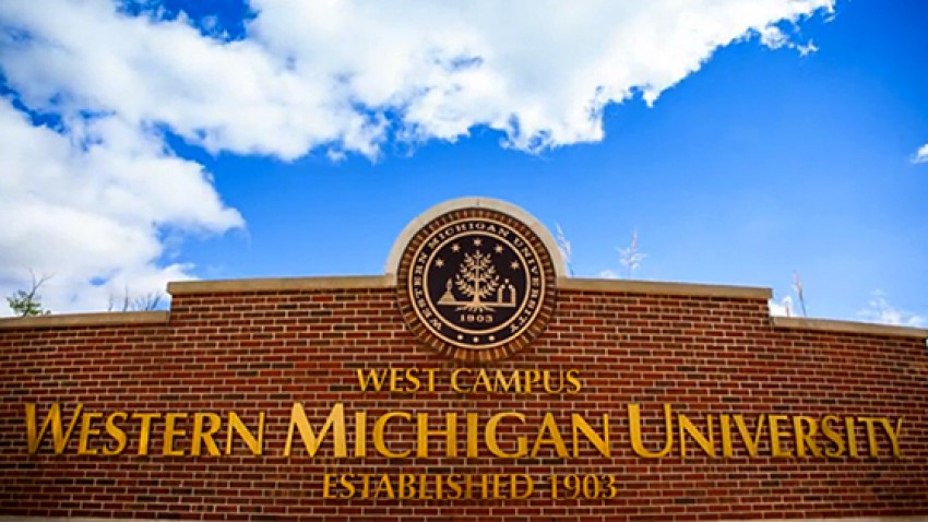 Photo of a WMU sign with blue sky.