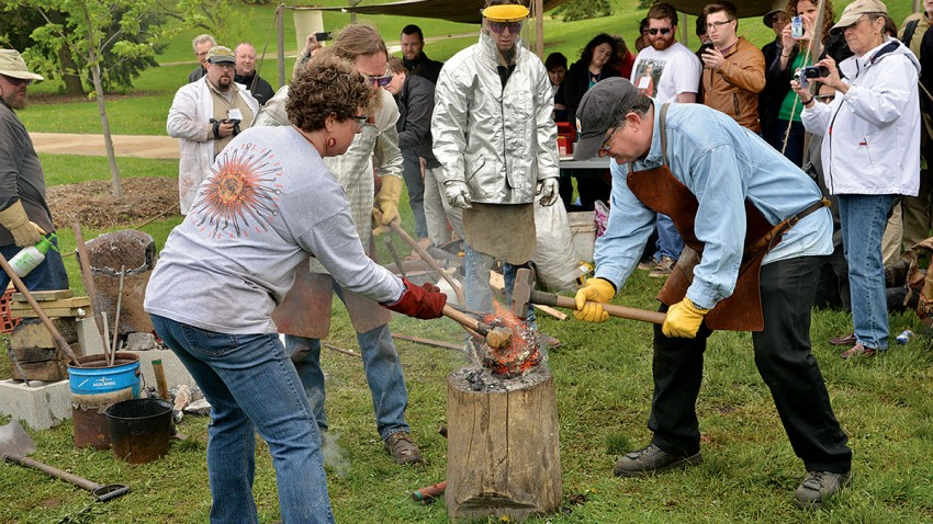 Photo of an iron-smelting demonstration.