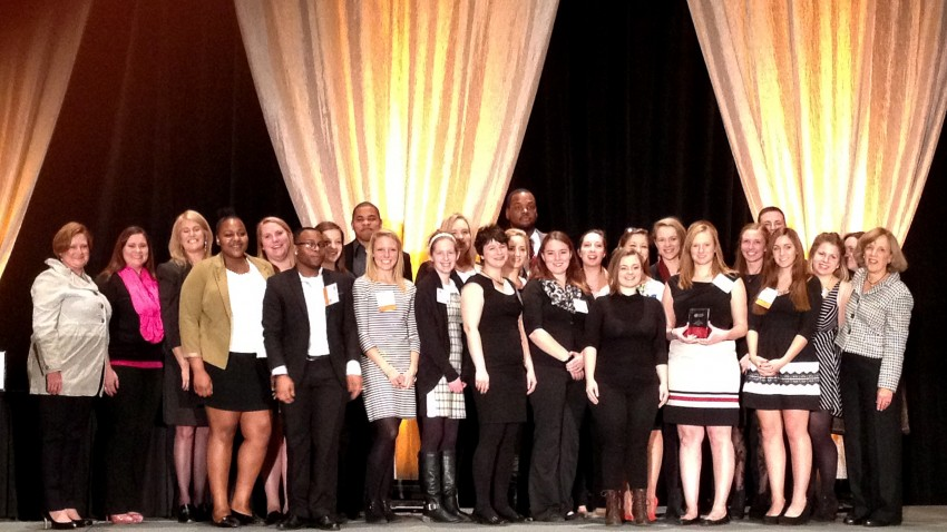 Photo of WMU students and faculty on stage accepting award.