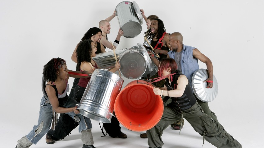 Photo of performers in Stomp.