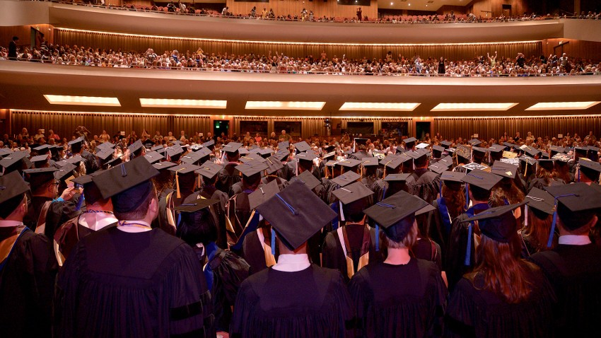 Photo of graduates in Miller Auditorium.