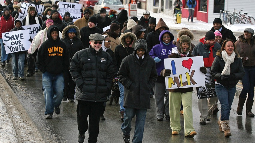 President Dunn marching with students