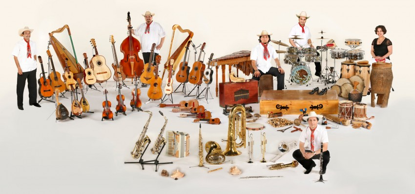 The six ensemble members surrounded by instruments.