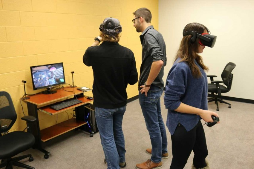 students exploring the VR lab in the library