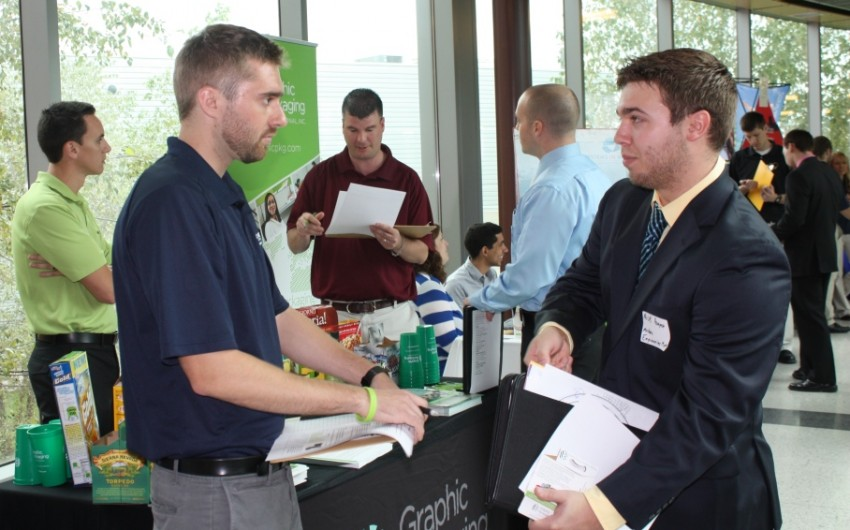Employer and student at career fair
