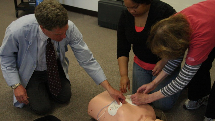 Photo of CPR training with AED.