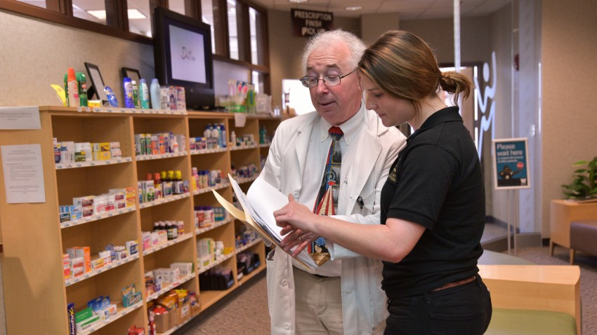 Photo of student and pharmacist at Sindecuse pharmacy