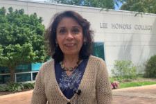 Dr. Irma Lopez standing outside the honors college building.