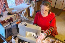 Kate MacKenzie sews in her home.