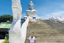 Erika Larsen Poses near a monument in Malaysia