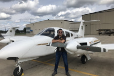 WMU Aviation Student - Trevor Thelen standing in front of a College of Aviation Piper Seminole