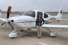 Ashley next to one of Western's Cirrus SR20 aircraft.