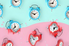 Illustration of blue and red alarm clocks against a pink and aqua backdrop