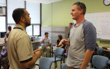 OMVA staff speaking with a new military student during an orientation event.