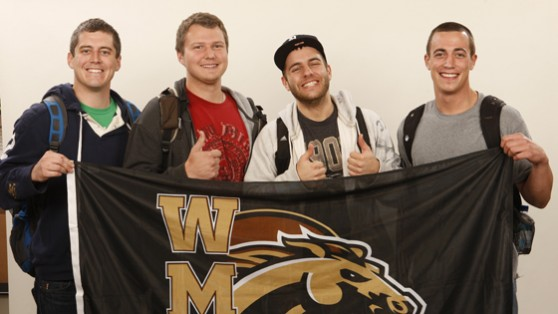 Photo of students with WMU flag