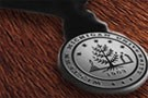 a silver Western medallion lying on a wooden table
