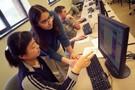 Students looking at a computer screen.