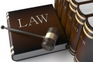 "Photo of large book labeled ""LAW"" with gavel"